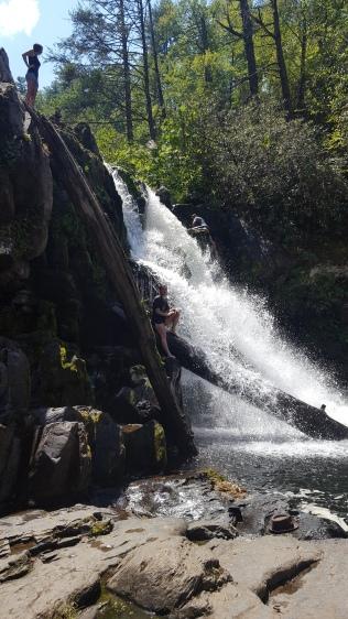 People climbing on the falls